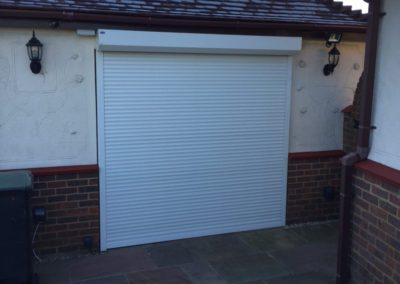 Chigwell home security shutter protecting patio doors.