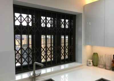 Security grilles on kitchen window.
