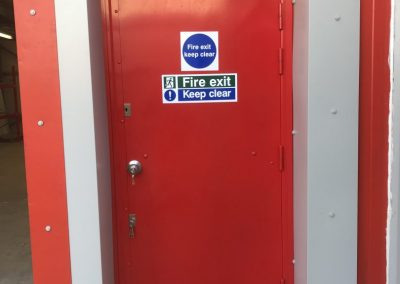 Fire exit steel door in Sidcup showing an external access knuckle and appropriate fire exit signage.